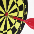 Dart on Dart Board - Stockfoto