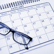 Calendar and Eyeglasses - Stock Photo