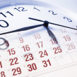 Clock Face and Calendar - Stock Photo