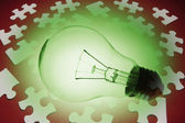 Light Bulb and Jigsaw Puzzle Pieces — Stock Photo