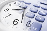 Wall Clock and Calculator — Stock Photo