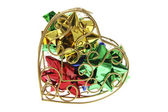 Gift Bows in Heart-Shaped Metal Box — Stock Photo