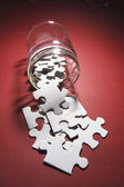 Jigsaw Puzzle Pieces Spilling From Glass Jar — Stok fotoğraf