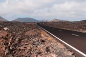 Road in volcanic scenery. — Stock Photo