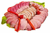 Dish with sliced ham, salami, sausage. — Stock Photo