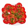 Royalty-Free Stock Photo: Sliced tomatoes with chive on plate.
