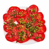Sliced tomatoes with chive on plate. — Stock Photo