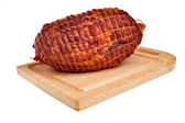 Big tasty smoked ham on board. — 图库照片