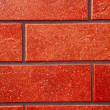 Dark red brick tile wall. — Stock Photo