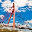 Pedestrian bridge over highway. - Stock Photo