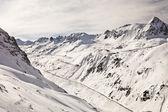 High Alpine road in winter. — Stock Photo