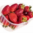 Fresh tasty strawberries in plastic container. - Stock Photo