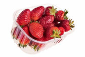 Fresh tasty strawberries in plastic container. — Stock Photo