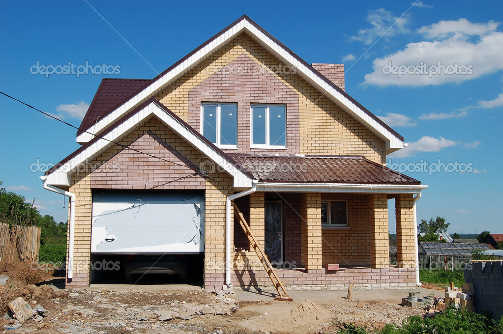 New home with stone facade on clear blue day — Stock Photo #2936569