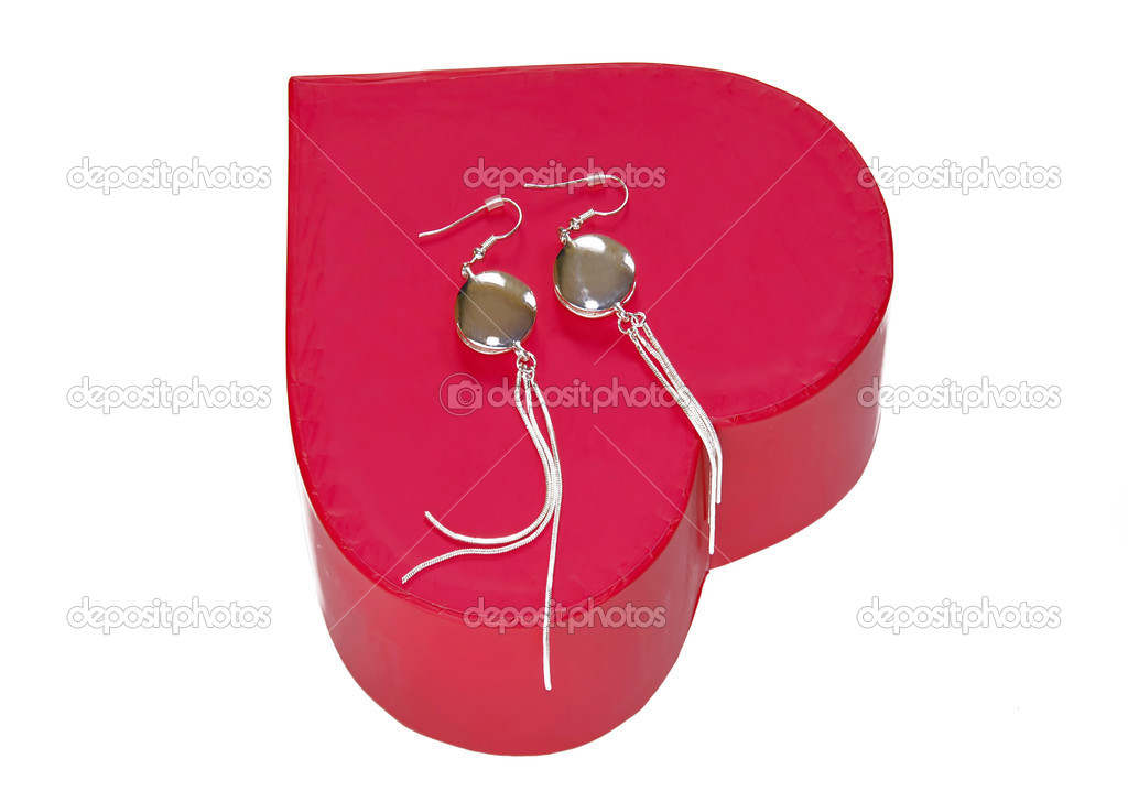 Silver earrings gift over red heart box isolated  Stock Photo #2707155