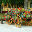 Stock Photo: Decorative cart with flowerpots
