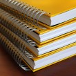 Stock Photo: Yellow notebooks stack