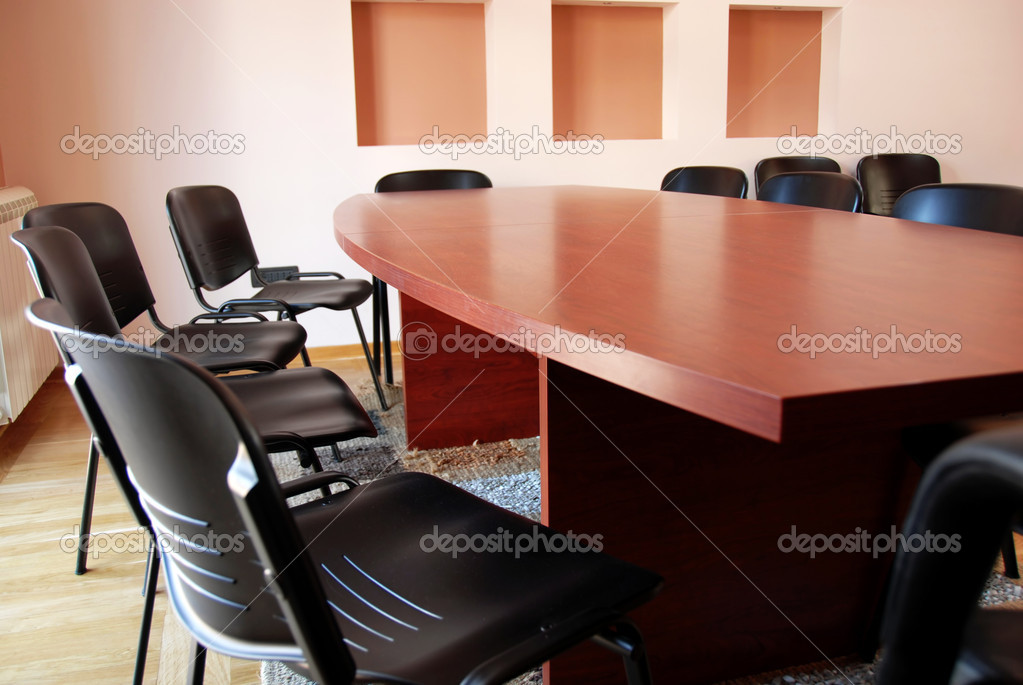 Brown office meeting desk and black chairs indoor — Stock Photo #2787850