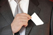 Businessman with business card — Stock Photo