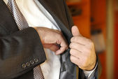 Businessman hand in inner pocket — Stock Photo
