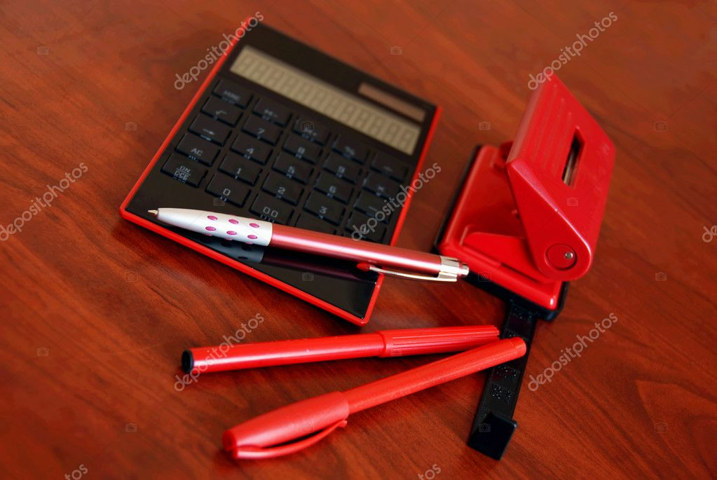 Black calculator, red pen and puncher on office desk — Stock Photo #2858346