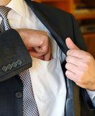 Businessman hand in inner pocket — Stock Photo