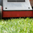 Mower in grass — Stock Photo