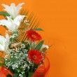 Flower bouquet over orange — Stock Photo