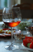 Wineglass with highlighted rose wine — Stock Photo