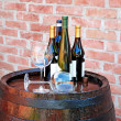 Wine over wood barrel — Stock Photo