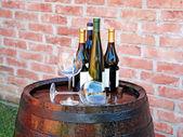 Wine over wood barrel — Stock Photo