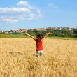 Happy girl jumping in wheat field — Stock Photo