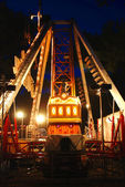 Carousel in evening park — Stock Photo