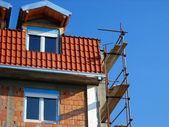 Scaffolding on building corner — Stock Photo