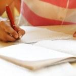 Schoolgirl doing her homework — Stock Photo