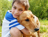 Boy hugging his dog — Stock Photo