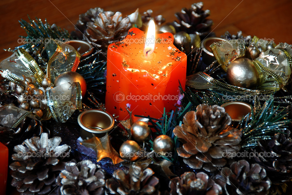 Burning orange star shape candle over new year decoration  Stock Photo #3292793