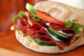 Appetizing sandwich with ham and vegetables — Stock Photo