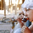 Girl drinking orient tea - Stockfoto