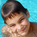 Teen boy in swimming pool portrait — Stock Photo