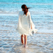 Stock Photo: Womin white dress at seaside