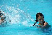 Kids having fun in swimming pool — Stock Photo