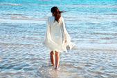 Woman in white dress at seaside — Stock Photo