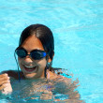 Teen girl in swimming pool portrait — Stock Photo