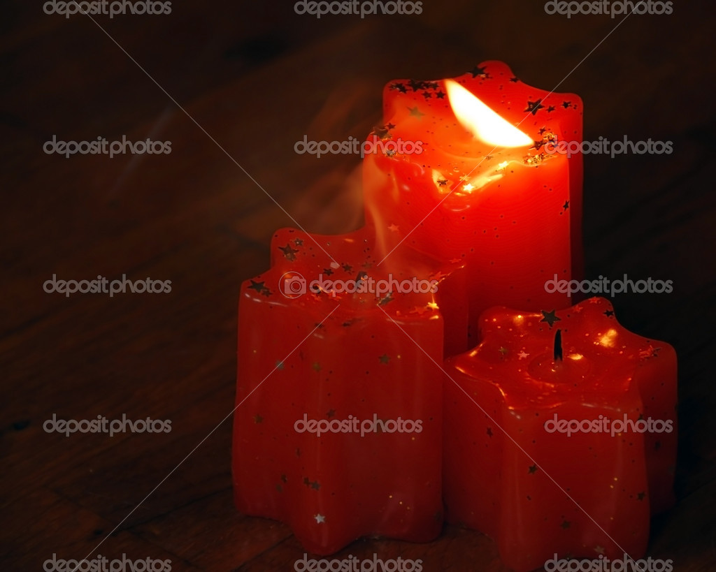 Blowing flame of orange candles with smoke — Stock fotografie #3755470
