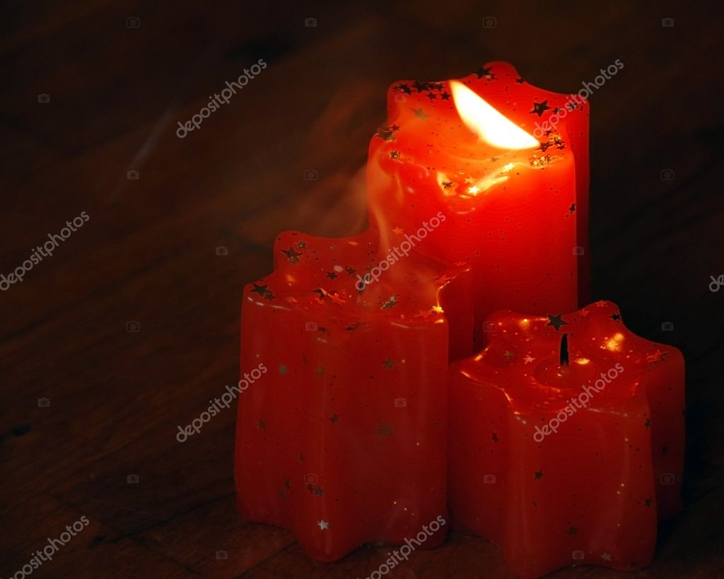 Blowing flame of orange candles with smoke  Photo #3755470