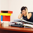 Despaired woman overloaded with work — Stock Photo