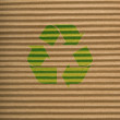 Brown cardboard texture and recycling sign — Foto Stock