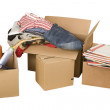 Transport cardboard boxes with books and clothes — Stock Photo
