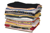 Stack of colored t-shirts — Stock Photo